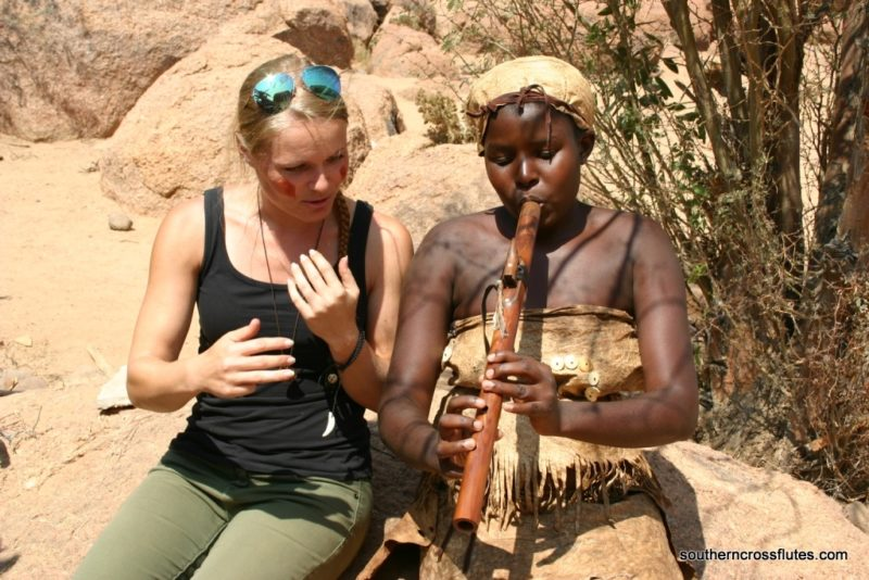 Melanie shows her Native American Flute to woman in Africa